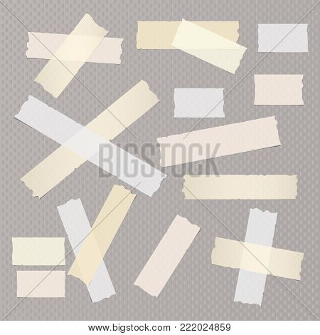 Brown and white different size adhesive, sticky, masking, duct tape, paper pieces on dark gray squared background