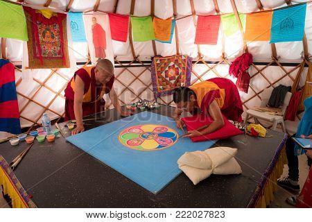 Buddhist Monks Making Sand Mandala, This Is A Tibetan Tradition Of Creation And Destruction Of Manda