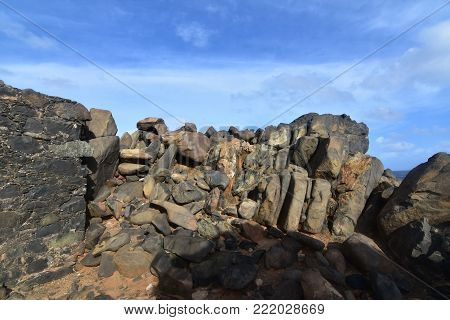 Large dark rocks located on an ancient gold mine