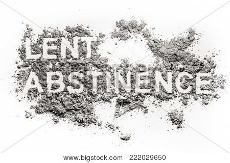 Lent abstinence word text written in ash, sand or dust as fasting and penance time before easter and ash wednesday holiday concept