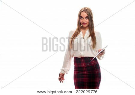 Opinion poll. Positive young girl in formal attire is holding paper and pen for writing on white background. Place for text