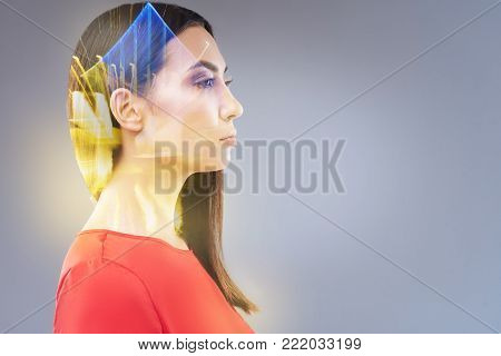Creative crisis. Beautiful irresistible smart woman posing in profile while looking into future and trying to concentrate
