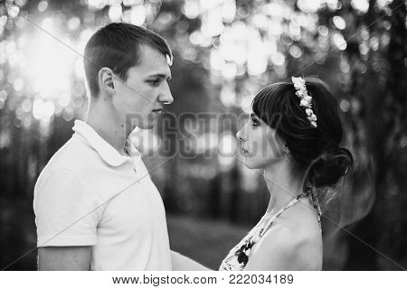 Black and white art monochrome photography. Black and white creative photography. Black and white conceptual image. Beautiful black and white background. Black and white portrait. Beautiful girl with dark hair in summer dress hugging a man