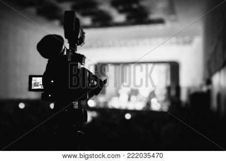Video camera at the concert. Capture a video. Black and white art monochrome photography. Black and white creative photography. Black and white conceptual image. Beautiful black and white background.