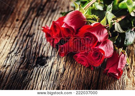 Red Roses. Bouquet Of Red Roses Free Lying On Rustic Oak Table