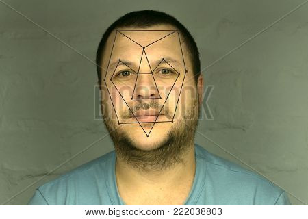 Biometric verification - young man face recognition line