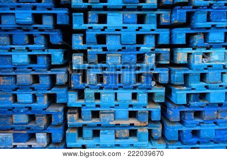 Stock of used blue wooden euro pallets at  the dock of a transportation company