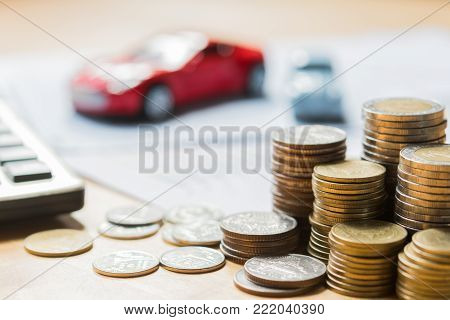 money and blur toy car with calculator. concept finance and insurance
