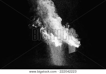 A stunning fire show against a dark night. Black and white art monochrome photography. Black and white creative photography. Black and white conceptual image. Beautiful black and white background.