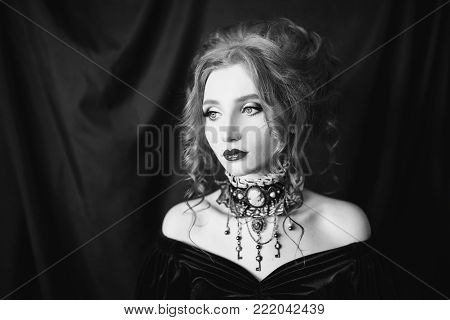 Black and white art monochrome photography. Black and white creative photography. Black and white conceptual image. Beautiful black and white background. Black and white portrait. A woman is a vampire with pale skin in a black dress