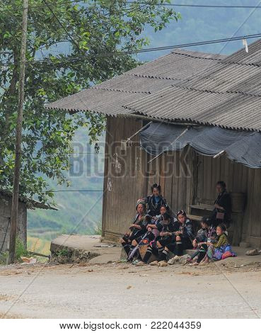 Sapa, Vietnam - Sep 21, 2013. Hmong people sitting at rural house in Sapa, Northern Vietnam. Sa Pa is a town in northwest Vietnam not far from the Chinese border.