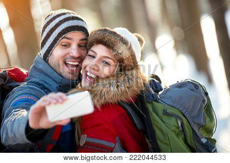 Selfie of young mountaineers couple