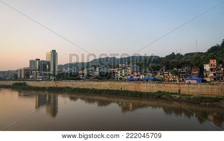 Sunset Over The City With A River