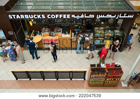 ABU DHABI, UNITED ARAB EMIRATES - DEC 31, 2017: Starbucks coffee in the Marina Mall in Abu Dhabi. This mall is the biggest and most modern of the city and spread out over 3 levels. Very popular by tourists.