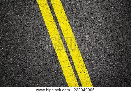Asphalt texture background with two yellow lines