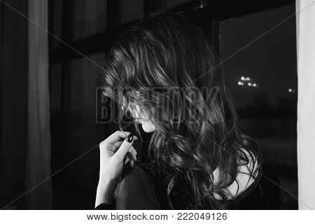 Black and white art monochrome photography. Black and white creative photography. Black and white conceptual image. Beautiful black and white background. Black and white portrait. Beautiful girl with long hair and natural make-up and pale skin.
