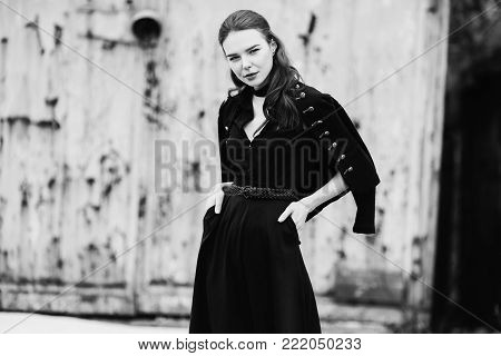 Black and white art monochrome photography. Black and white creative photography. Black and white conceptual image. Beautiful black and white background. Black and white portrait. Striking girl with long long hair in black clothes.
