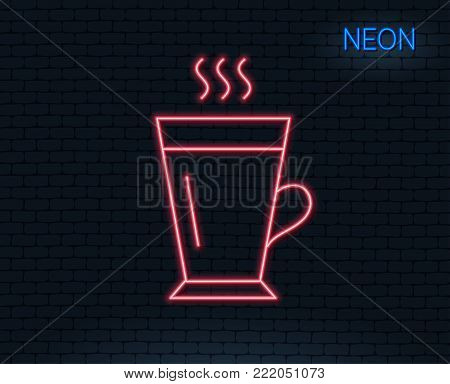 Neon light. Latte line icon. Hot Coffee or Tea sign. Fresh beverage symbol. Glowing graphic design. Brick wall. Vector