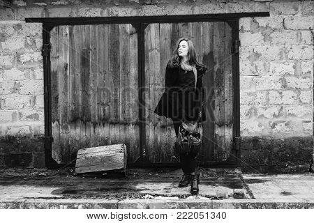 Black and white art monochrome photography. Black and white creative photography. Black and white conceptual image. Beautiful black and white background. Black and white portrait. Striking girl with long hair in black clothes.