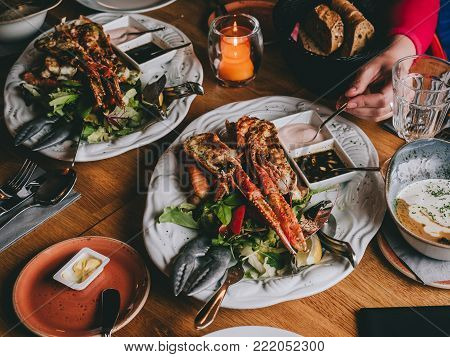 Langoustines on salad with sauces in restaurant in Hofn, Iceland