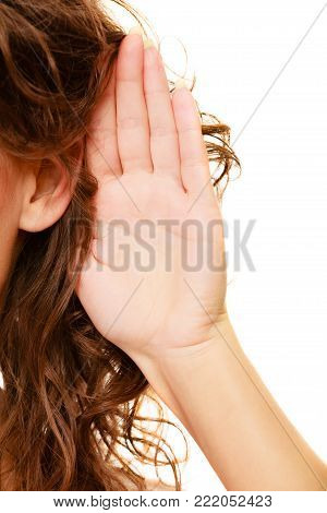 Part of head woman female hand to ear listening isolated on white background. Gossip
