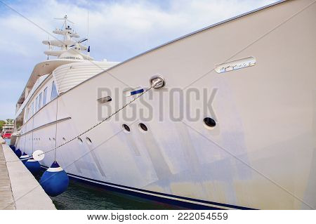 super white yacht at anchor on port