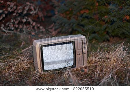 White noise on analogue TV set in outdoor environment