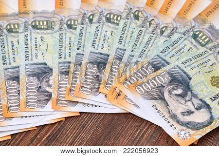 Pile of banknotes on a table (hungarian forint)