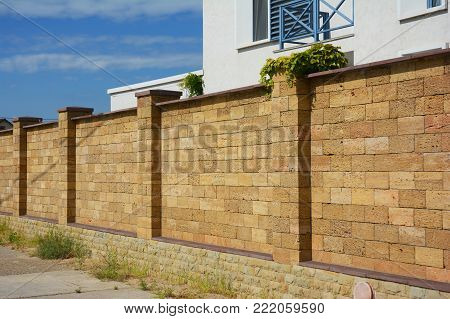 Beautiful Coquina,  Shelly Limestone Fence Wall. Natural Stone Fencing.