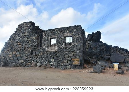 Blue skies on a dark stoned gold mining ruins