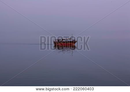 Misty Seascape and tourism boat at  the See Genezareth  in Israel