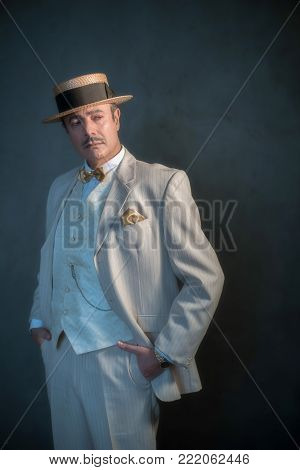 Retro 1920S Upper Class Man In Suit And Hat Standing With Cane.