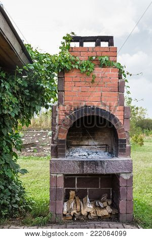 large vintage brick outdoor brazier for cooking barbecue