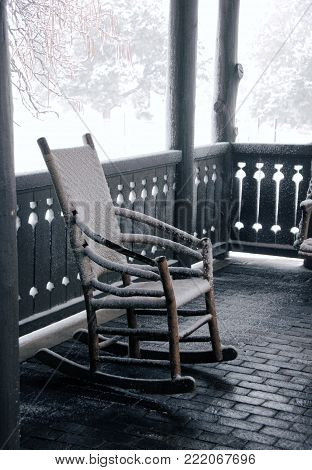 Cozy rocking chair on an airy porch, in the snow. Grand Canyon winter.