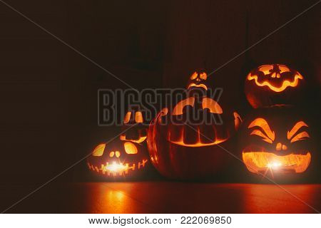 Ghost pumpkins on Halloween. ead Jack on Dark background. Holiday indoor decorations