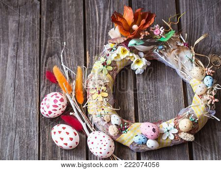 Easter Wreath On A Wooden Background