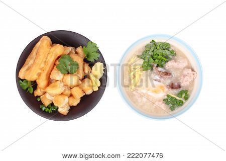 Iso;ated of Chinese recipe,Rice porridge with  boiled egg ,Minced pork ,chicken liver, Ginger, onion and coriander served with Patongko ,deep-fried dough stick.