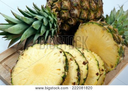 Slices of pineapples on a cutting board closeup