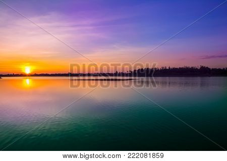 Sunset sky background. Dramatic gold sunset sky with evening sky clouds over the sea. Stunning sky clouds in the sunse
