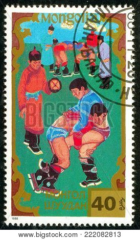 Ukraine - circa 2018: A postage stamp printed in Mongolia shows Wrestling, Traditional Mongolian sport. Series: Sports. Circa 1988.