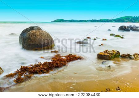 Moeraki Boulders on the Koekohe beach, Eastern coast of New Zealand.