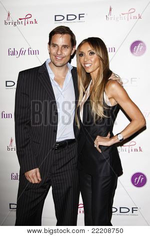 LOS ANGELES, CA - MAR 3: Bill Rancic and wife Giuliana Rancic at the launch party for 'FabFitFun' hosted by Giuliana Rancic at The Redbury in Los Angeles, California on March 3, 2011