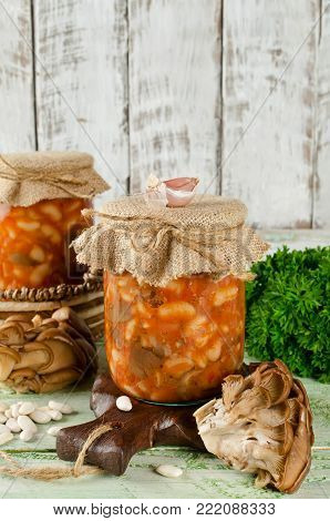 Salad with beans and mushrooms preserve in glass jar. Homemade canning winter preserve