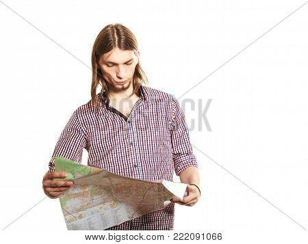 Man tourist reading map on trip. Young guy searching looking for direction guide. Summer vacation travel. Isolated on white background.