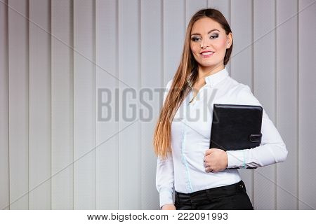Career business work in office. Young woman in formal wear hold case with files documents paperwork.