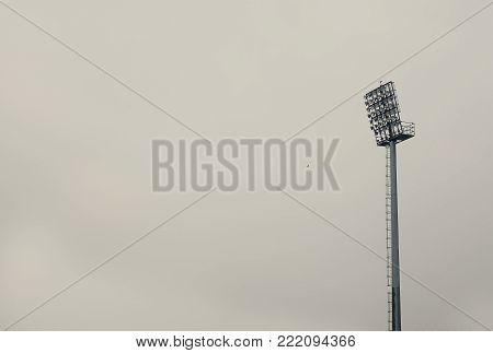 An abstract composition, one large reflector on  football stadium