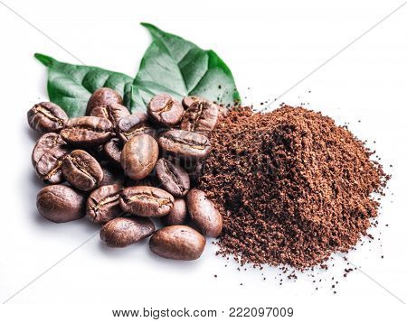 Roasted coffee beans ground coffee on white background.