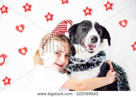 Happy Girl And Dog At Christmas
