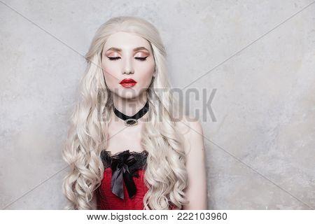 Stylish blonde girl in retro dress posing in studio. Fashion Photo. Beautiful fashion young girl. Sexy fashion young woman. Attractive fashion thin model. Stylish fashionable dress on girl. Fashion concept