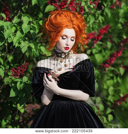 Stylish redhead girl in retro dress posing in nature. Fashion Photo. Beautiful fashion young girl. Sexy fashion young woman. Attractive fashion thin model. Stylish fashionable dress on girl. Fashion concept